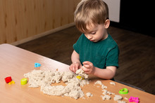 A Three-year-old Boy Plays At ...