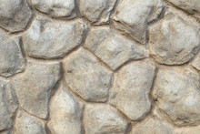 Decorative Border Of The Building Facade Made Of Concrete In The Form Of Large Stones