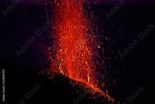 Fotografie, Tablou Molten Lava Erupting From Stromboli Volcano At Night