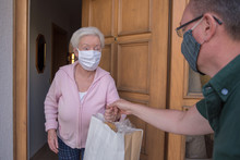 Senior Woman With Face Mask Ge...
