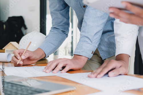 Fototapety, obrazy: Image of engineer meeting for architectural project. working with partner and engineering tools on workplace