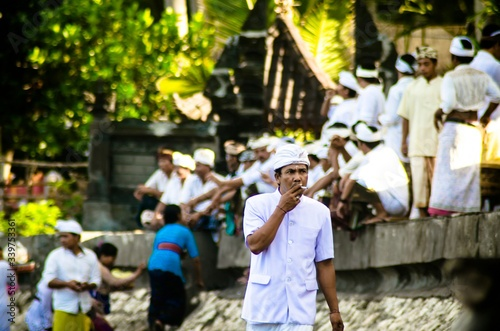 Canvas Young Man In Traditional Clothing Smoking While Standing Outdoors