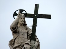 Jesus Christ Statue With Cross Against Clear Sky