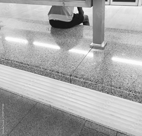Obraz Man Sitting On Marble Railing - fototapety do salonu