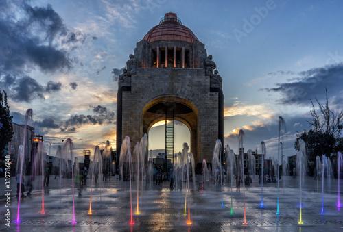 Fototapeta Blurred Motion Of Fountain Against Monument To The Revolution