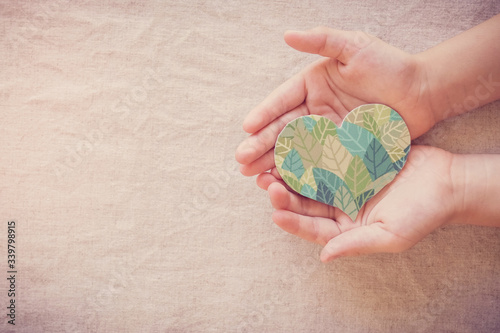 Hands holding leaf heart shape, CSR social responsibility, eco sustainable living, vegan, world environment day, Earth Day