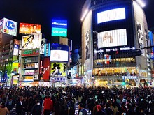 Crowd On Street Against Illuminated Billboards At Shibuya