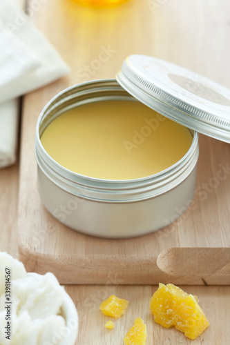 beeswax on a wooden background Wallpaper Mural
