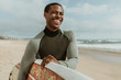 Smiling male surfer