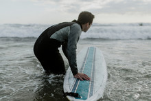 Male Surfer In The Water