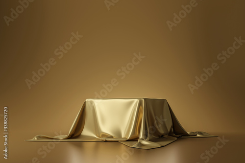 Obraz na plátně Golden luxurious fabric placed on top pedestal or blank podium shelf on gold background with luxury concept