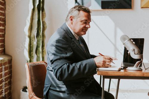 Fényképezés Businessman recording a podcast