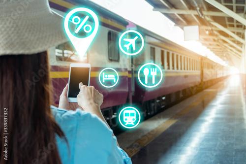 Cuadros en Lienzo Young backpacker tourist on train platform use wi-fi internet online smartphone