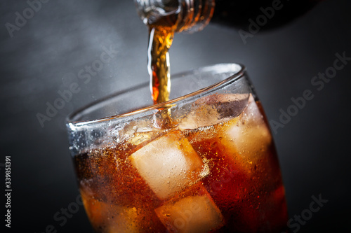soft drink, pouring cola into glass Canvas Print