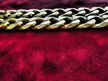 Detail Of Chains On Red Surface