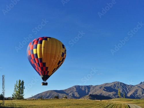 Hot Air Balloon Flying Against Clear Blue Sky Fototapeta