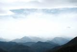 Fototapeta Do pokoju - clouds over the mountains