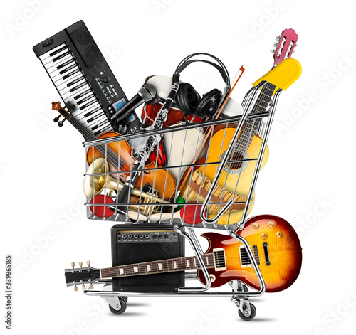 stack pile collage of various musical instruments in shopping cart. Electric guitar violin piano keyboard bongo tamburin harmonica trumpet. store online shop studio music concept isolated background