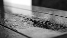 Close-up Of Wet Wooden Table During Monsoon