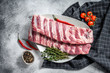 canvas print picture - Fresh raw pork ribs with spices and herbs. Gray background. Top view
