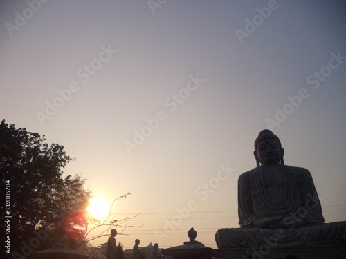 Fototapety, obrazy: Low Angle View Of Buddha Statue At Sunset