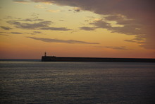 Newhaven Lighthouse, Sunset, Seaford, UK, July 2019