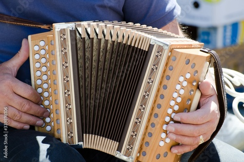 Closeup shot of a male playing the accordion Canvas-taulu