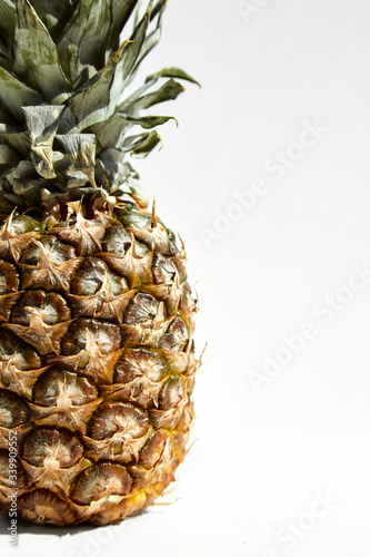 Fototapety, obrazy:  Ripe pineapple fruit on a white background.Close-up.