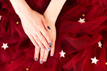 Stylish Manicure On Red Textil...