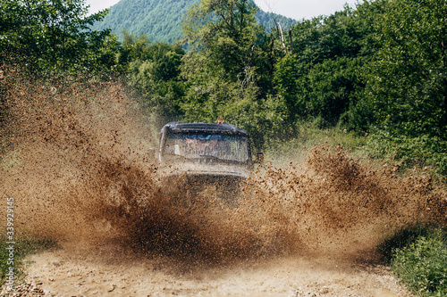 Offroad car on bad road Fototapeta