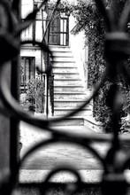Stairway Seen Through Wrought Iron Window