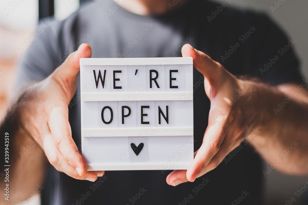 Fototapeta End of quarantine. Greeting message We're open