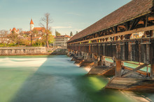 Picturesque View Of Thun Castle In The City Of Thun, With Beautiful Old Wooden Bridge Over The River, Canton Of Bern, Switzerland