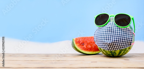 Tropical beach idea when stay home. Creative minimal summer holiday concept with fresh watermelon.