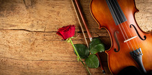 Classic Retro Violin Music String Instrumt With Red Rose Flower Old Oak Wood Wooden Wide Panorama Background. Classical Musical Romantic Valentines Day Concept.