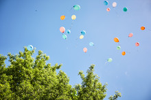 Balloons Fly Away On A Backgro...
