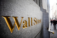 A Wall Street Sign In Wall St,...