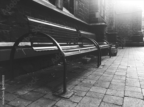Canvas Empty Benches On Cobbled Footpath By Building