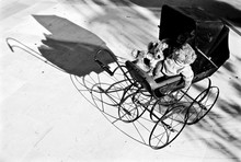 High Angle View Of Baby Carriage With Toys