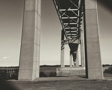 Low Angle View Of Commodore Barry Bridge Against Sky