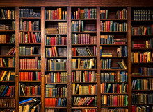 Books On Shelves In Library Or...