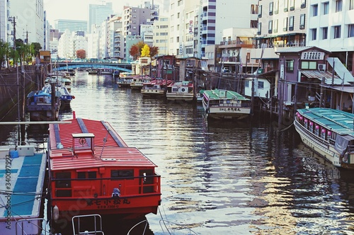 Boats Moored In City Fototapeta