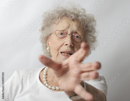 Old female with grey hair refusing to take a picture Tablou Canvas