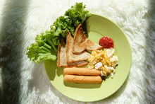 The Breakfast Light And Shadow In The Morning On The Green Disk .Sausage, Eggs, Bread, Lettuce