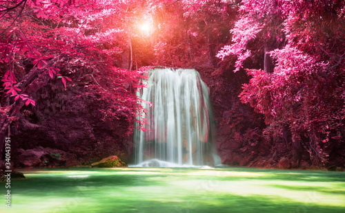 Beautiful waterfall with sunlight in autumn forest at Erawan National Park, Thailand, Nature landscape  - 340143751