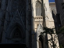 Low Angle View Of St Patrick Cathedral By Buildings