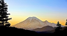 Scenic View Of Snowcapped Mt Rainier At Sunset