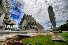 Wat Rong Khun Against Cloudy Sky