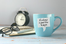 A Notebook,glasses,pen,notebook,vintage Alarm Clock, And A Mug With Speech Bubble Written With Inspirational Motivation Quotes It's Always A Good Time To Begin.