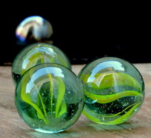 Close-up Of Green Marble Balls On Table